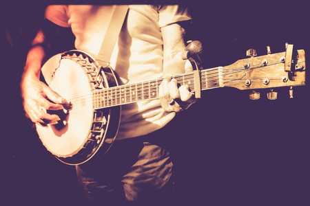 musician playing banjo in retro color  filter photo 写真素材