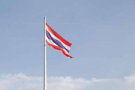 thai flag: waving Thai flag on blue sky and white cloud