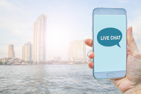 live work city: Live Chat Chatting Communication Concept on smart phone Stock Photo