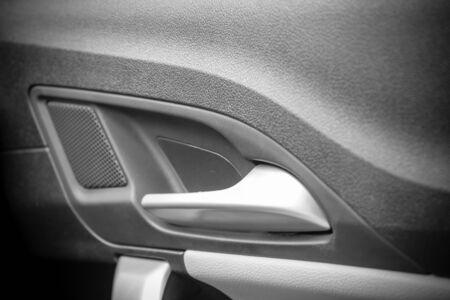 door handle: door handle inside car in black and white