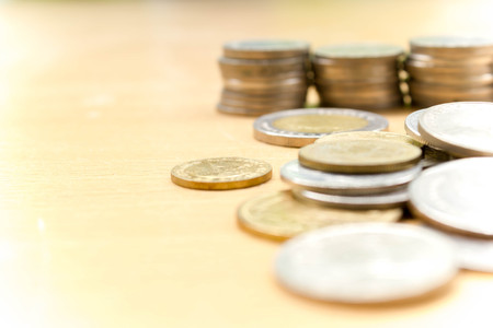 money concept: blur stack of coins on wood table : for background use Stock Photo