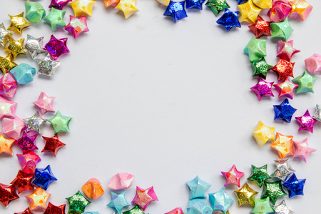 origami paper: colorful folded paper star or origami lucky star to use as frame