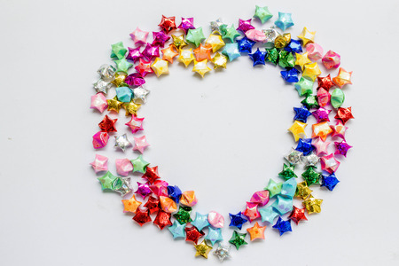 Colorful Folded Paper Star Or Origami Lucky In Heart Shaped To Use As Frame Stock