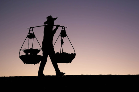 silhouette of Asian man peddler hawker on abstract background Stock Photo