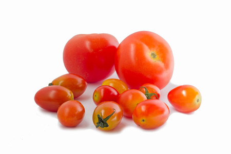 fresh tomatos and cherry tomatos isolated on white background
