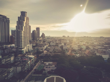 blurred city building in Bangkok with sunlight