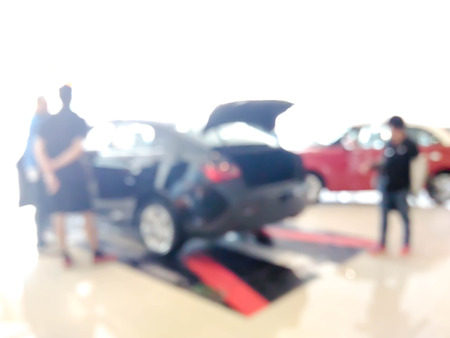 blurred car showroom with salesman and customers : for background use Stock Photo