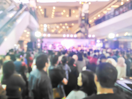 abstract blurred people listening music band in shopping mall Stock Photo