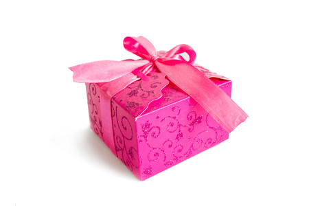 pink gift box with ribbon on white background
