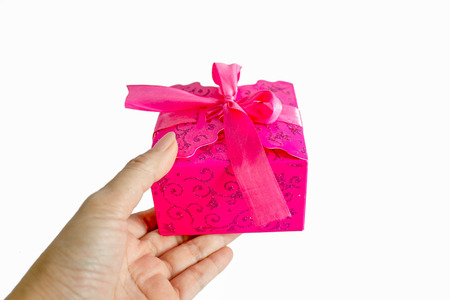 hand giving pink gift box isolated on white background Stock Photo