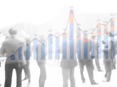 financial graph: double exposure of performance graph and abstract blurred crowd of businessman and woman in black and white