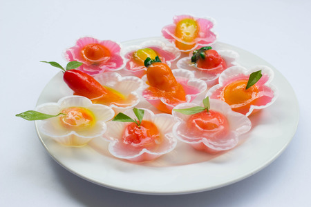 Kanom Look Choup mix in jelly  (kanom woon look choup) : Thai traditional dessert made from green been, coconut milk, sugar and jelly in fruit shape