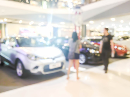 blurred visitors at motor show in shopping mall : for background use Stock Photo