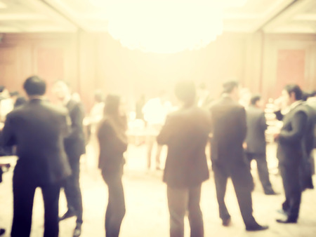 abstract blurred crowd of businessman and woman with soft sunlight
