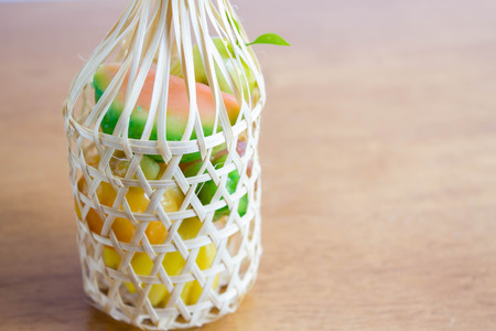 Kanom Look Choup  : Thai traditional dessert made from green been, coconut milk, sugar and jelly in fruit shape put in wicker round bamboo  basket