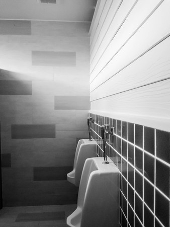 urinal men public toilet in black and white