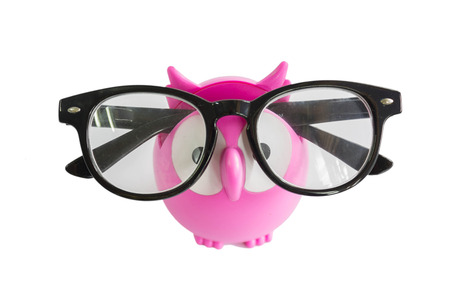 cute pink owl for holding glasses isolated on white background Stock Photo