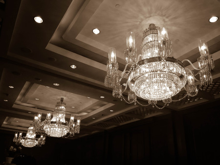 elegant chandelier on the ceiling in retro filter Stock Photo