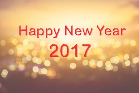 de focused: Happy New Year text on blur bokeh background Stock Photo