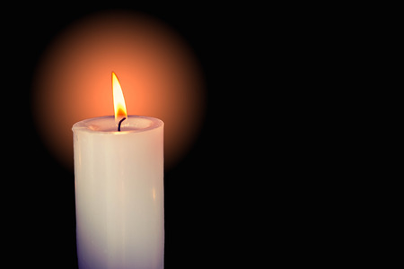 close up of white candle light in the dark Stock Photo