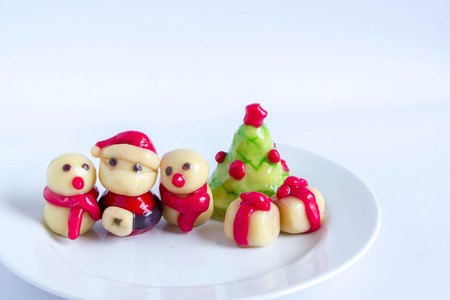kanom Look Choup : Thai traditional dessert made from green been, coconut milk, sugar and jelly in Christmas theme (ThaI Mung Bean Marzipan)