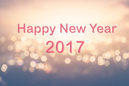 text year: Happy New Year text on blur bokeh background Stock Photo