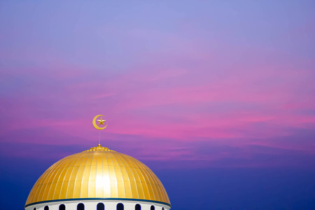 masjid dome (mosque) on red sky background Stock Photo