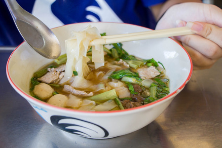 wide rice noodles with beef and meat ball soup