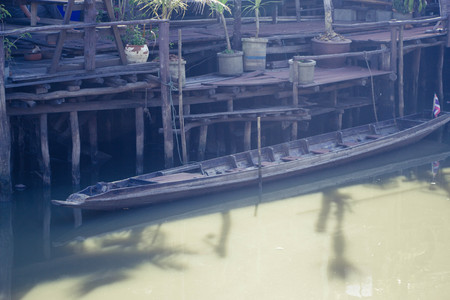 Thai ancient wooden boat in the canal Stock Photo