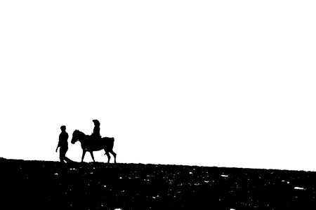 silhouette Dad walking with daughter riding on horse on white background 写真素材