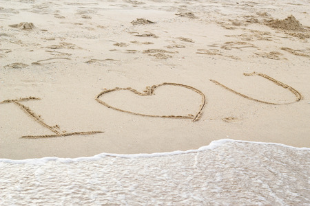 love message written by hand on the beach 写真素材