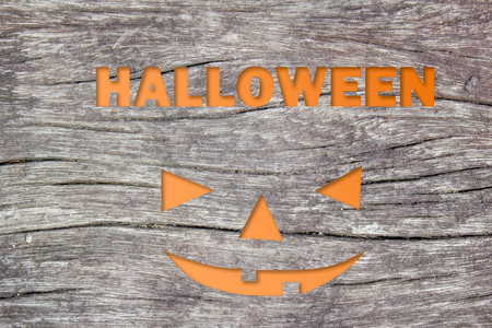 Halloween text on grungy wood background texture 写真素材