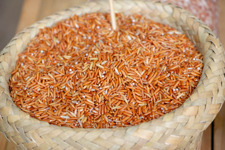 Sangyod brown rice in the basket (a traditional rice in Pattalung provice, Thailand) 写真素材