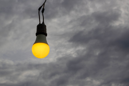 lightbulb on dark scary  sky background
