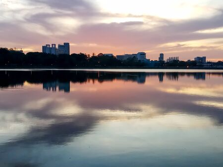 beautiful sunset sky over  the river with background of building in town 写真素材