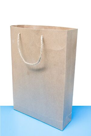 natural brown paper bag on blue ground