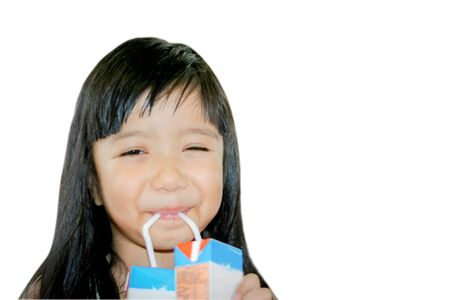 Asian funny happy kid drink two box of milk on white background