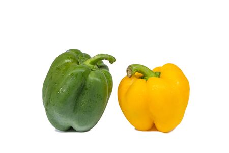 fresh green and yellow bell peppers with water drop isolated on white background