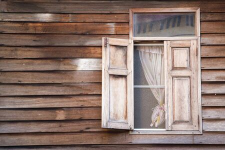 rustic wood window with curtain