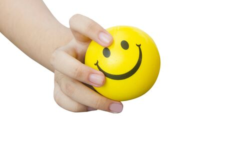 right hand hold happy yellow anti stress ball, happiness is in your hands concept