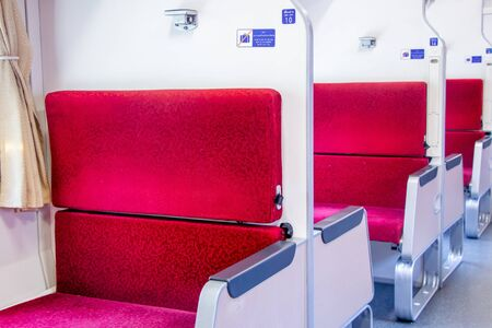 empty passenger red seat in Thai train