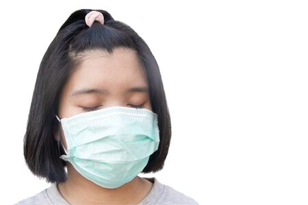 Asian teenager wearing protective medical mask for prevent spreading of Corona virus Covid-19