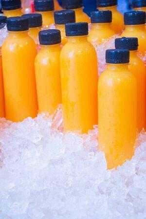 pure orange juice in  plastic bottles with black caps