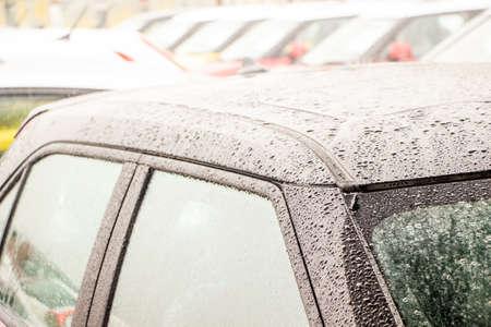 rain drop on car roof in rainny season