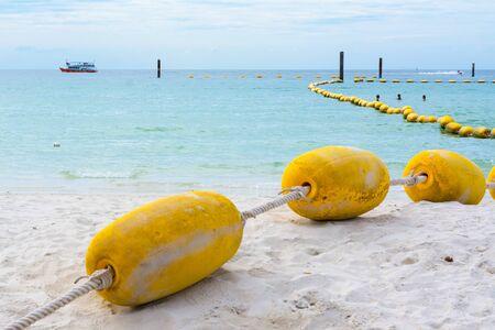 buoyancy: Buoyancy with algae on the beach down to the sea. Stock Photo