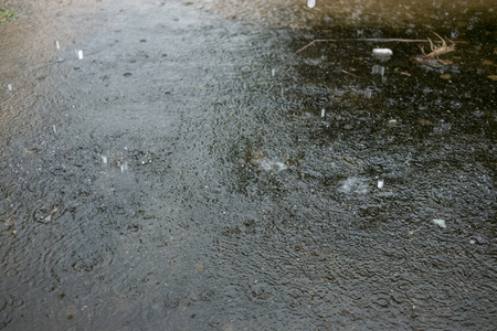 Raindrop fall on the road Standard-Bild