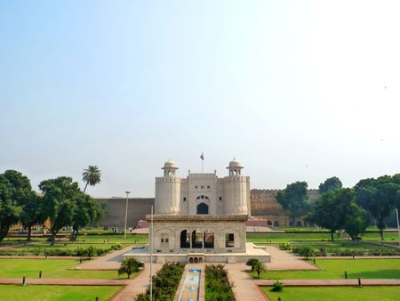punjab: Exterior View of Lahore Fort (Shahi Qilla) with small garden in foreground. Lahore Fort is located opposite to Badshahi Mosque in Lahore and is one of the most visited tourist destination.  Stock Photo