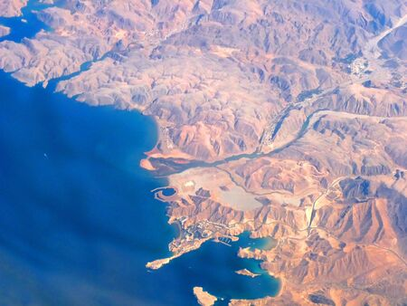 Oman: Aerial View of Oman Coastline taken from 35000 ft in the Air showing Qaboos Port & Surroundings.