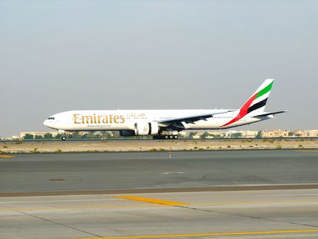 DUBAI, UAE - NOVEMBER 18: Emirates Boeing 777 aircraft landing during Dubai Air Show at Airport Expo Dubai