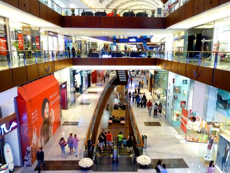 retail place: DUBAI, UAE - SEPTEMBER 06: Shoppers at Dubai Mall September 06, 2010 in Dubai, United Arab Emirates. Dubai Mall is one of the largest mall in the world.